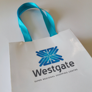 Branded ribbon handle bag